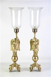 Sale 8905S - Lot 628 - A pair of gilt bronze hurricane lamp with angelic figure holding shade. Height 72cm