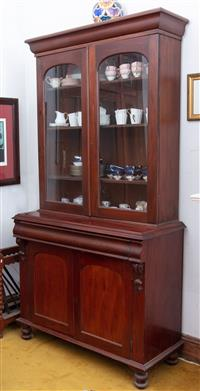Sale 8934H - Lot 12 - A C19th cedar display cabinet/ bookcase with glazed doors above a frieze drawer and cupboard base revealing a shelved interior, Heig...