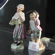 Sale 8362 - Lot 10 - Continental Handpainted Figure of a Flower Seller with a Figure of a Boy