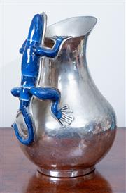 Sale 8800 - Lot 50 - A handmade Mexican silver water jug by A Fajardo with an iguana handle, H 28cm