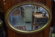 Sale 8542 - Lot 1036 - Gilt Framed Oval Bevelled Edge Mirror