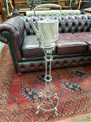 Sale 8576 - Lot 1004 - Unusual Silver Plated Kettle on Floor Stand, the kettle with slanted flutes, on a tall spirit stand with ribbon twist supports & rai...