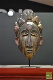 Sale 8515 - Lot 1011 - Urhobo Tribal Nigerian Mask on Stand