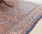 Sale 8550H - Lot 100 - A large antique Persian carpet of geometric foliate design on red ground with cream spandrels and central lozenge, has several damag...