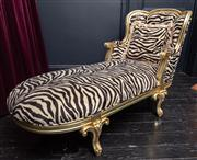Sale 8761A - Lot 17 - A chaise lounge with zebra button back upholstery with silver painted frame  Height of back 90cm, total Length approx 170cm, W x 69cm