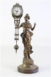 Sale 8905S - Lot 631 - A cast metal figural pendulum clock. Height 33cm