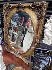 Sale 8925 - Lot 1063 - An oval and gilt framed mirror (98 x 81.5cm)