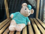 Sale 9051 - Lot 1010 - Terracotta Reclining Bear in Sweater (H:20cm)