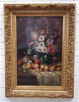 Sale 9142 - Lot 1075 - Max Albert Carlier (Belgian 1872-1938), Still Life with Flowers, Fruit, Pastries & Object DArt in good gilt gesso frame - tears to...