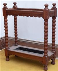 Sale 8934H - Lot 19 - An oak umbrella stand with bobbin turned legs, Height 76cm x Width 65cm x Depth 26cm
