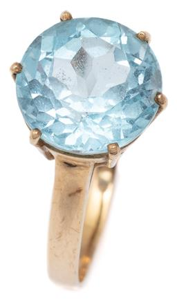 Sale 9115 - Lot 319 - A 9CT GOLD SOLITAIRE TOPAZ RING; claw set with a round cut blue topaz of approx. 8.10ct, size S, width 13mm, wt. 4.42g.