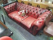 Sale 8648C - Lot 1067 - Red Leather Button Back Three Seater Chesterfield Lounge