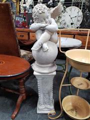 Sale 8925 - Lot 1078 - A composite figure of a cherub on a pedestal