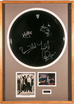 Sale 9136 - Lot 19 - Rolling Stones autographed drum skin from the Voodoo Lounge Tour, dated 1997 frame: 104 x 75 cm -
