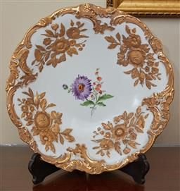 Sale 9098H - Lot 56 - A Meissen cabinet plate with purple and orange painted floral motif amidst a gilt rose border painted and incised marks to rear, dia...