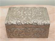 Sale 8368A - Lot 14 - A decorative embossed tin jewellery box, 25 x 17 x 12cm