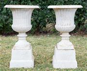 Sale 8422A - Lot 15 - A pair of cast iron urns painted white (two pieces), height 67cm