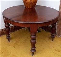 Sale 8934H - Lot 31 - A cedar circular extension centre table on baluster legs to castors, Diameter 122cm x Height 75cm Each leaf 42cm x 43cm x 44cm   S...