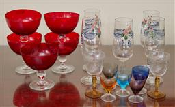 Sale 9098H - Lot 58 - A quantity of coloured drinking glasses, five red, five painted swag, five harlequin shot glasses and two amber stem sherry glasses.