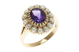 Sale 9213 - Lot 349 - AN AMETHYST AND PEARL CLUSTER RING; centring an oval cut fine deep purple amethyst to surround of seed pearls, in 9ct gold, top 16 x...