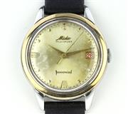 Sale 8644W - Lot 94 - MIDO MULTIFORT POWERWIND WRISTWATCH; sunburst dial, center seconds, date, screw down back, case diam. 35mm, new leather band, repain...