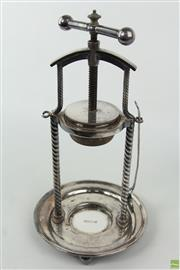 Sale 8594D - Lot 33 - Late Edwardian Silverplated Juicer