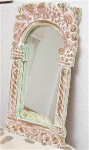 Sale 9066H - Lot 187 - A rustic wall mirror with carved fruit decoration to frame and pink and gilt highlights 68cm x 41cm
