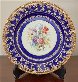 Sale 9098H - Lot 60 - A Paragon Bone China cabinet plate with floral bouquet on a gilt and blue border, diameter 28cm