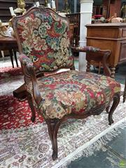 Sale 8634 - Lot 1027 - Probably Louis XV Period Carved Walnut Fauteuil, with early bold patterned tapestry, raised on cabriole legs