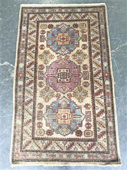 Sale 9121 - Lot 1079 - Multi-coloured woollen triple medallion carpet (158 x 93cm)