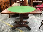 Sale 8666 - Lot 1024 - Regency Rosewood Card Table, the hinged top above a cross-banded frieze, turned and petal carved pedestal, on quadraform base with p...