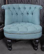 Sale 8761A - Lot 39 - A buttonback bedroom tub chair in baby blue on ebonised turned feet, H x 67cm Faults to legs.