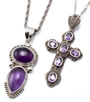 Sale 8982 - Lot 321 - TWO SILVER AMETHYST PENDANT NECKLACES; one set with oval and pear cabochon amethyst with wire twist and bead style decoration, size...