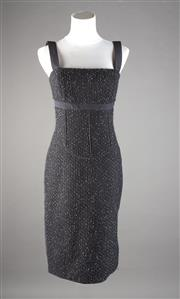 Sale 8499A - Lot 2 - A Narciso Rodriguez wool & acrylic, silk line black bobble with white fleck fabric below-knee sheath dress, made in Italy. Size: 40.