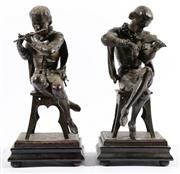 Sale 9010 - Lot 66 - A Good Pair of Spelter Figures of Seated Violin & Flute Players H: 37cm