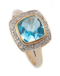 Sale 9107J - Lot 371 - A 9CT GOLD TOPAZ AND DIAMOND RING; centring a buff top cushion cut blue topaz ( 8 x 8mm) to surround of single cut diamonds, size O,...