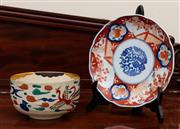Sale 8882H - Lot 54 - An antique Japanese pottery bowl painted with a phoenix in kakiemon palette (small chip) together with a Imari plate with fence patt...
