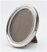 Sale 9085S - Lot 16 - George V Sterling Silver photo frame, hallmarked Birmingham 1918, height 10.5cm