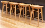 Sale 8741A - Lot 64 - Four elm tractor seat form barstools on tapering legs, H x 69cm