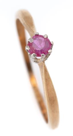Sale 9107J - Lot 353 - A VINTAGE 18CT GOLD SOLITAIRE RUBY RING; claw set with a round cut pink ruby (approx. 0.15ct), size L 1/2 (ring worn), wt. 1.60g.
