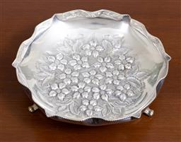 Sale 9140H - Lot 8 - A 925 silver tri-footed floral decorated embossed dish with pinched rims, Diameter 16cm, Weight 112g