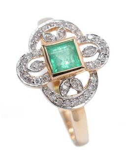 Sale 9213 - Lot 347 - AN EDWARDIAN INSPIRED EMERALD AND DIAMOND RING; centring a carre cut emerald to 9ct gold pierced foliate surround set with round bri...