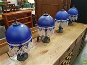 Sale 8601 - Lot 1307 - Set of Four Blue Glass Shade Table Lamps