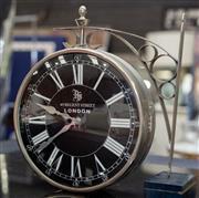 Sale 8709 - Lot 1065 - A double sided station style clock on bracket, 9 Regent St London, diameter of clock 19cm