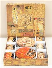 Sale 8855H - Lot 87 - A set of six cups and saucers decorated with Woman in Gold by Gustav Klimt