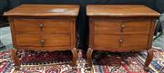 Sale 8971 - Lot 1017 - A Pair of French Style Timber Effect Two Drawer Bedside Cabinets (H:65 x W:68 x D:56cm) purchased at the House of Manor Mosman