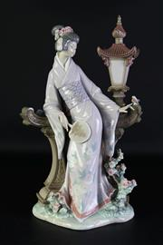 Sale 8989 - Lot 60 - Large Lladro figure of a geisha surrounded by flowers (H40cm)