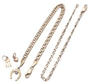 Sale 9037 - Lot 303 - TWO 9CT GOLD BRACELETS; a 4.mm wide double curb link with parrot clasp and metal charms, length 20cm, other 2.6mm wide short and lon...