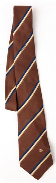 Sale 9080F - Lot 82 - A GUCCI 100% SILK TIE; in brown with tan and blue stripes