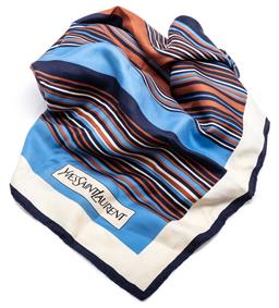 Sale 9145 - Lot 351 - AN YVES SAINT LAURENT SILK SCARF; striped pattern of navy, sky blue and tan on a cream background with a hand rolled edge, 77 x 77 c...
